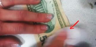 man rubbing money